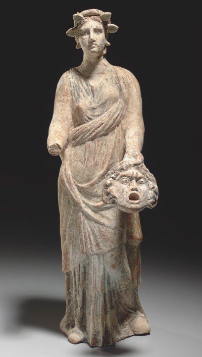 A GREEK TERRACOTTA FEMALE