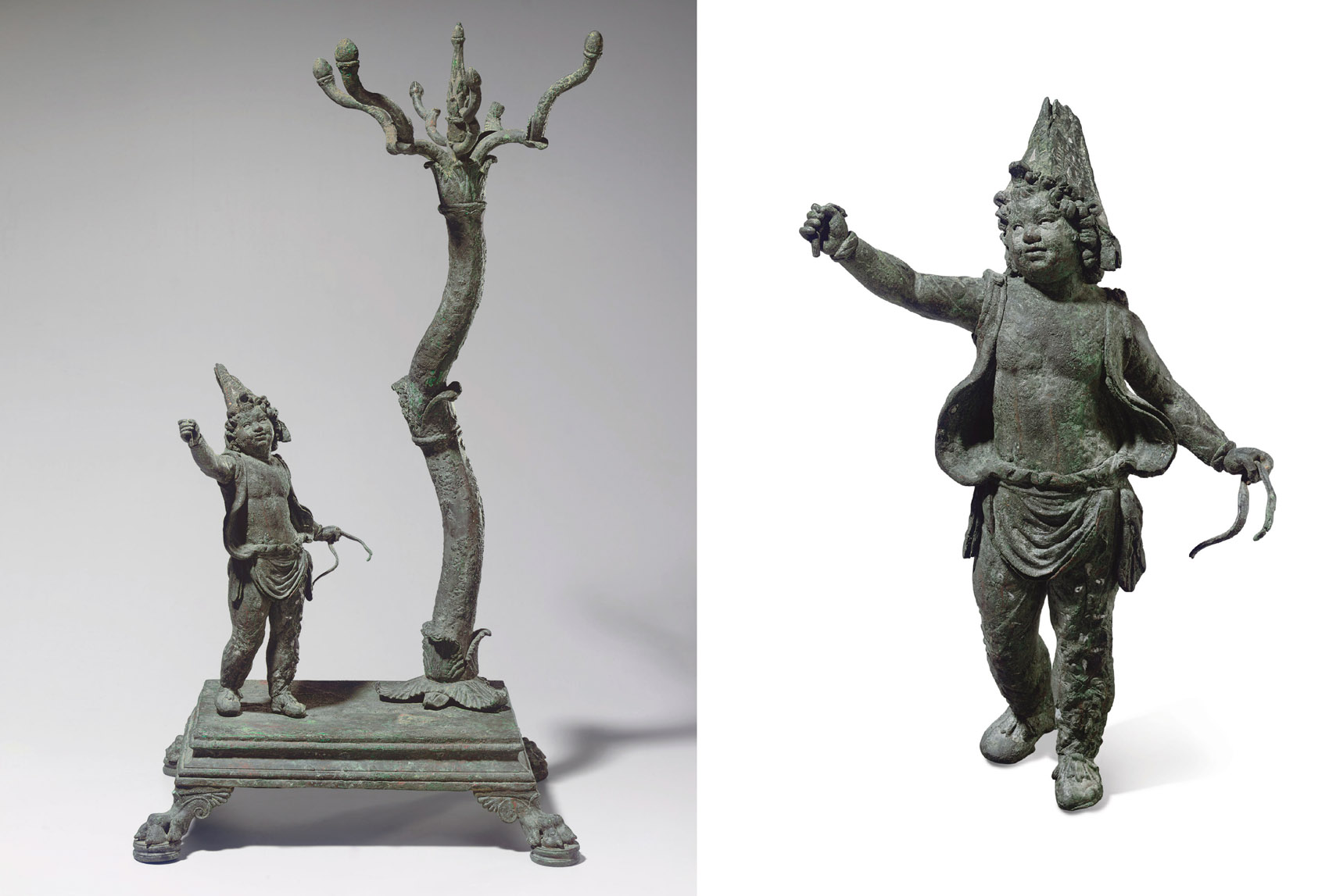 A ROMAN BRONZE LAMP STAND WITH A YOUTH