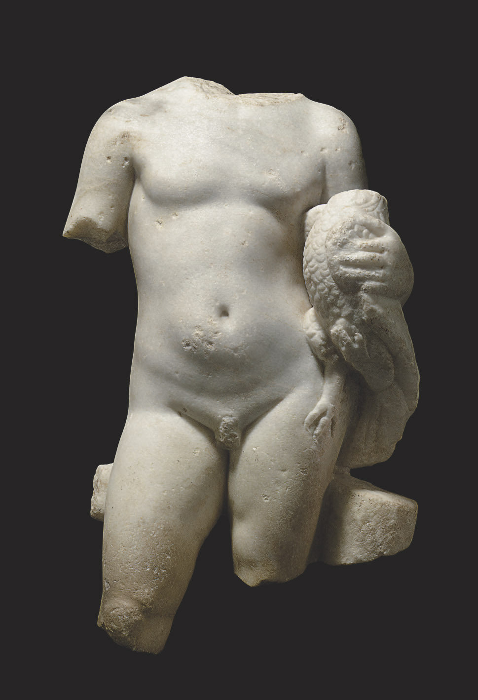 A ROMAN MARBLE TORSO OF A YOUTH