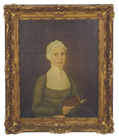 Portrait of a woman holding a book