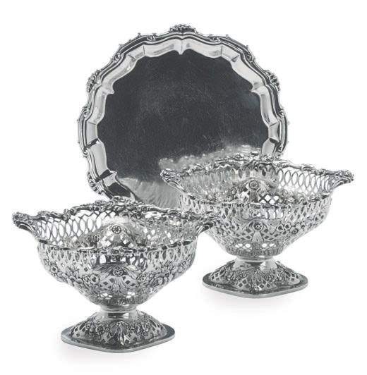 A GEORGE II SILVER WAITER AND A PAIR OF EDWARD VII FOOTED NUT DISHES,
