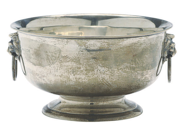A GEORGE V SILVER BOWL WITH LION-FORM RING HANDLES,