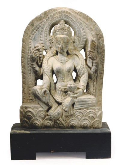 A NEPALESE-STYLE CARVED STONE