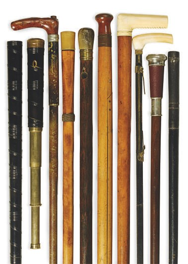 A GROUP OF NINE WALKING STICKS