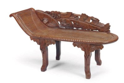 A CARVED HONGMU CHAISE-LOUNGE,