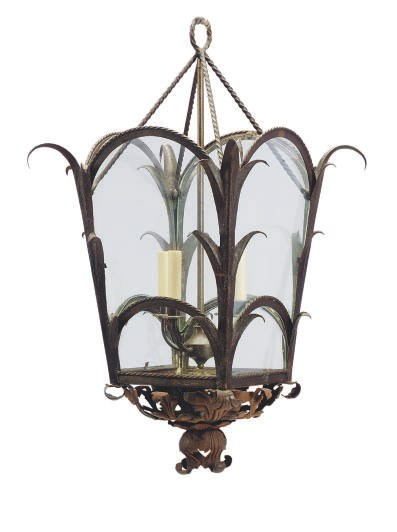 A BROWN-PAINTED WROUGHT-IRON A