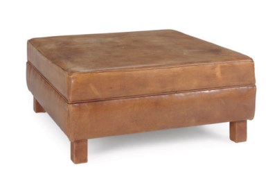 A TAN LEATHER-UPHOLSTERED OTTO