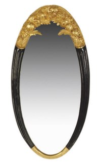A PARCEL-GILT AND EBONIZED OVAL MIRROR