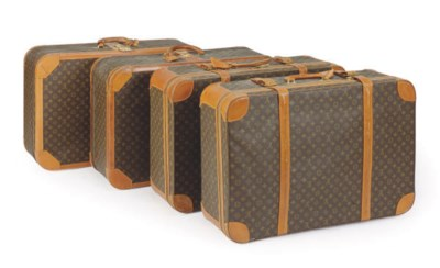A SET OF FOUR LOUIS VUITTON SO