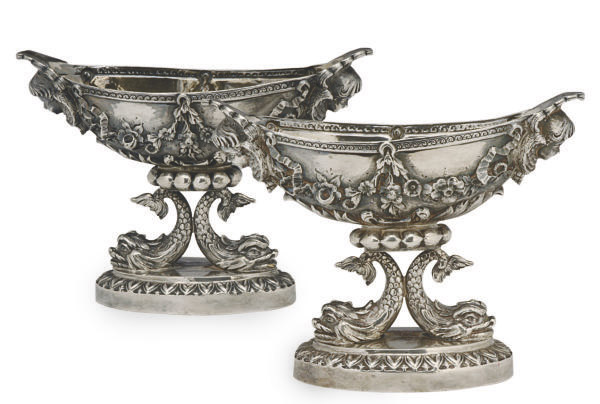A PAIR OF CONTINENTAL SILVER SALT CELLARS ON DOLPHIN-FORM BASES,