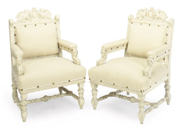 A PAIR OF CONTINENTAL BAROQUE STYLE CREAM-PAINTED LIBRARY ARMCHAIRS,