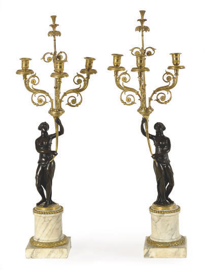 A PAIR OF FRENCH PATINATED AND GILT-BRONZE AND MARBLE FIGURAL CANDELABRA,