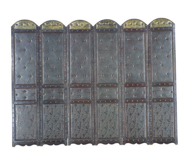 A BRASS STUDDED AND LEATHER UPHOLSTERED EBONIZED SIX PANEL FLOORSCREEN,