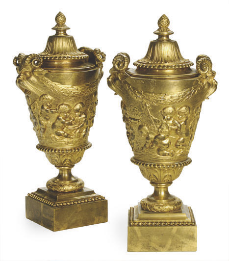 A PAIR OF GILT BRONZE URNS AND COVERS AFTER A MODEL BY CLAUDE MICHEL, CALLED CLODION (1738-1814)