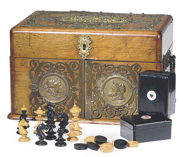 A VICTORIAN WALNUT AND BRASS BOUND GAMES BOX,