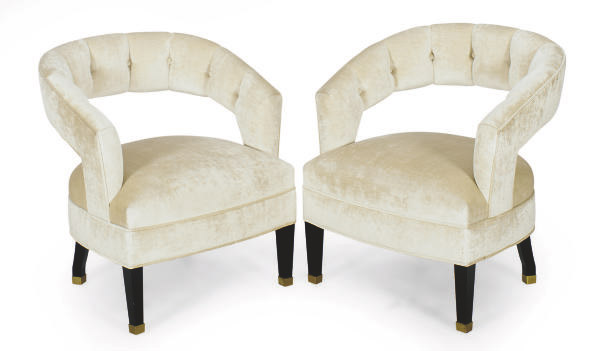 A PAIR OF EBONIZED AND BUTTON-TUFTED BARREL BACK ARMCHAIRS,