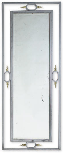 A POLISHED STEEL AND GITL-BRONZE WALL MIRROR,
