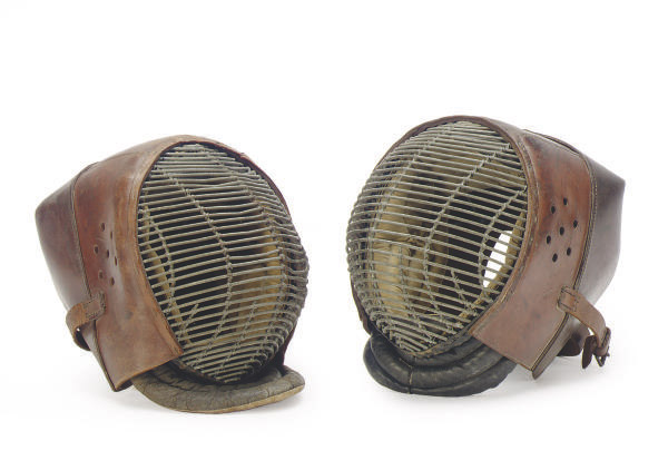A PAIR OF LEATHER, VELVET AND METAL FENCING MASKS,