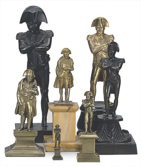 A GROUP OF SEVEN BRONZE AND METAL FIGURES OF NAPOLEON,