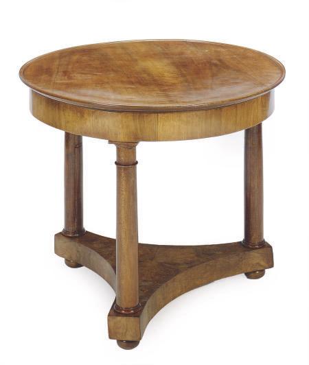 AN EMPIRE WALNUT CIRCULAR CENTER TABLE,
