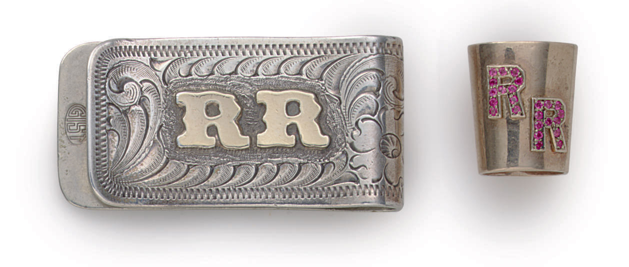 A SILVER ENGRAVED MONEY CLIP