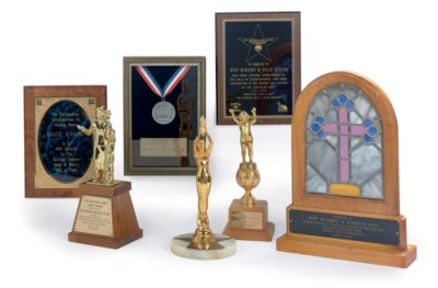 A GROUP OF AWARDS AND TROPHIES