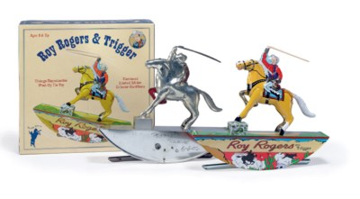 VINTAGE REPRODUCTION TIN WIND-