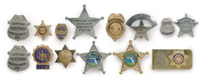 A GROUP OF FOURTEEN BADGES