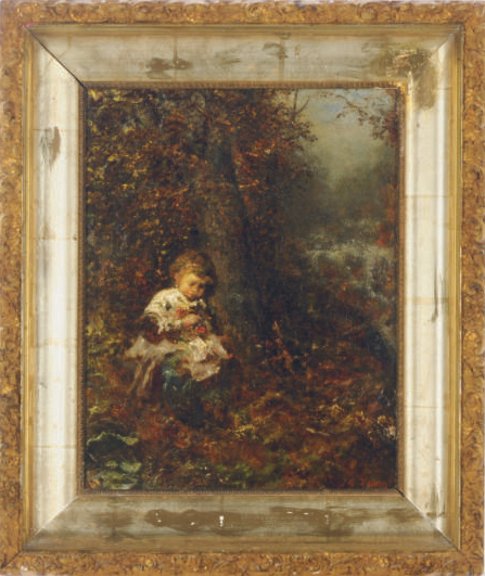 A child playing in the woods