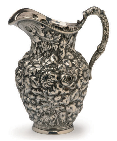 AN AMERICAN SILVER REPOUSSE WATER PITCHER,