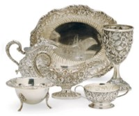 AN ASSEMBLED AMERICAN SILVER REPOUSSE PART TABLE SERVICE