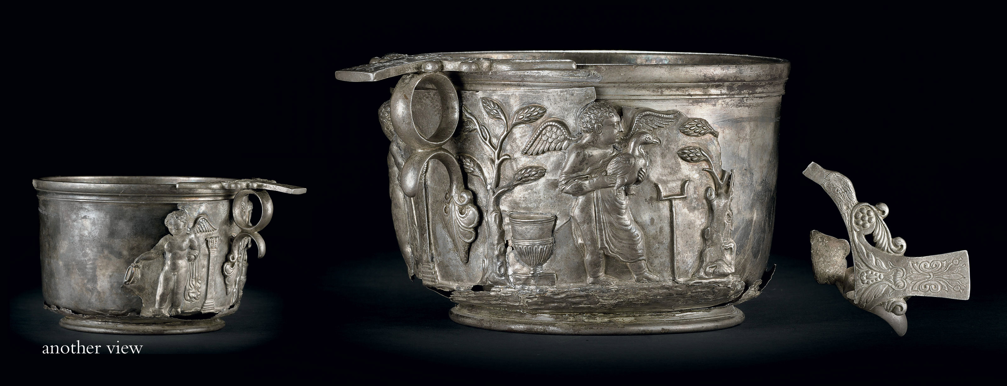 A silver skyphos with cupids