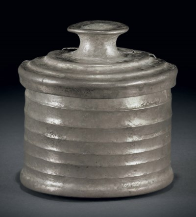 A silver pyxis with cover