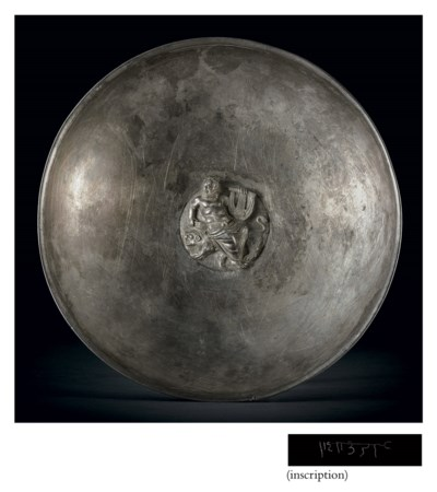 A silver phiale with medallion