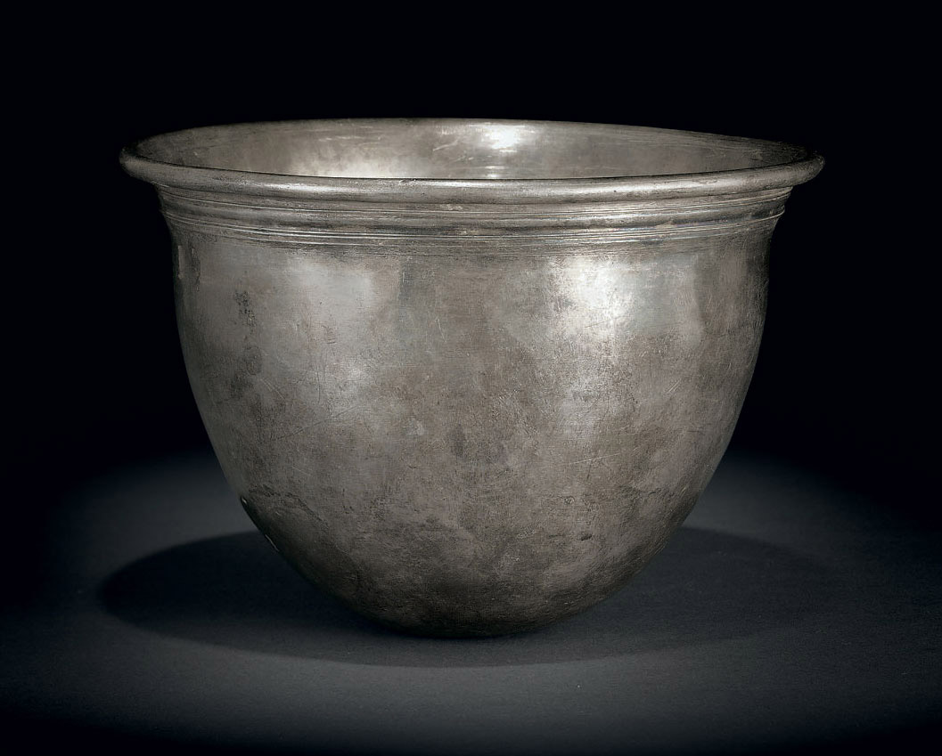 A silver cup liner