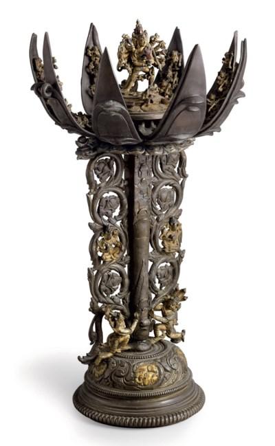 A rare articulated bronze mand