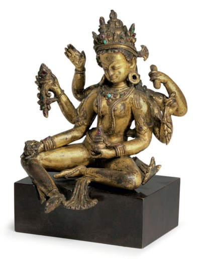 A gilt copper figure of Vasudh