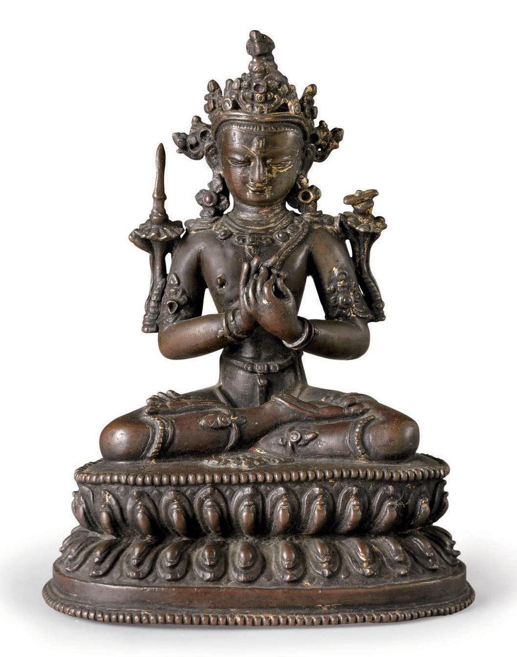 A bronze figure of Manjushri