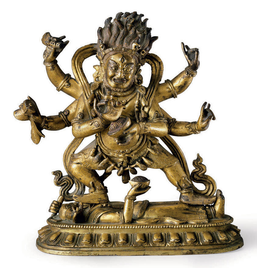 A bronze figure of a Shadbhuja