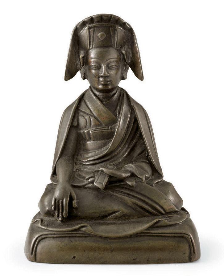 A bronze figure of a Lama