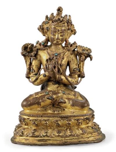 A small gilt bronze figure of