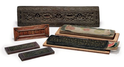 Two carved wooden bookcovers a