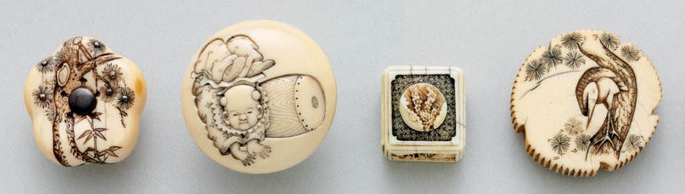 A group of ivory netsuke **