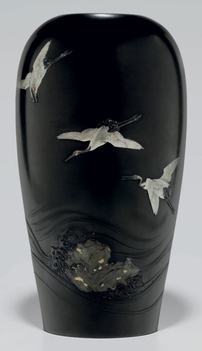A soft-metal-inlaid vase