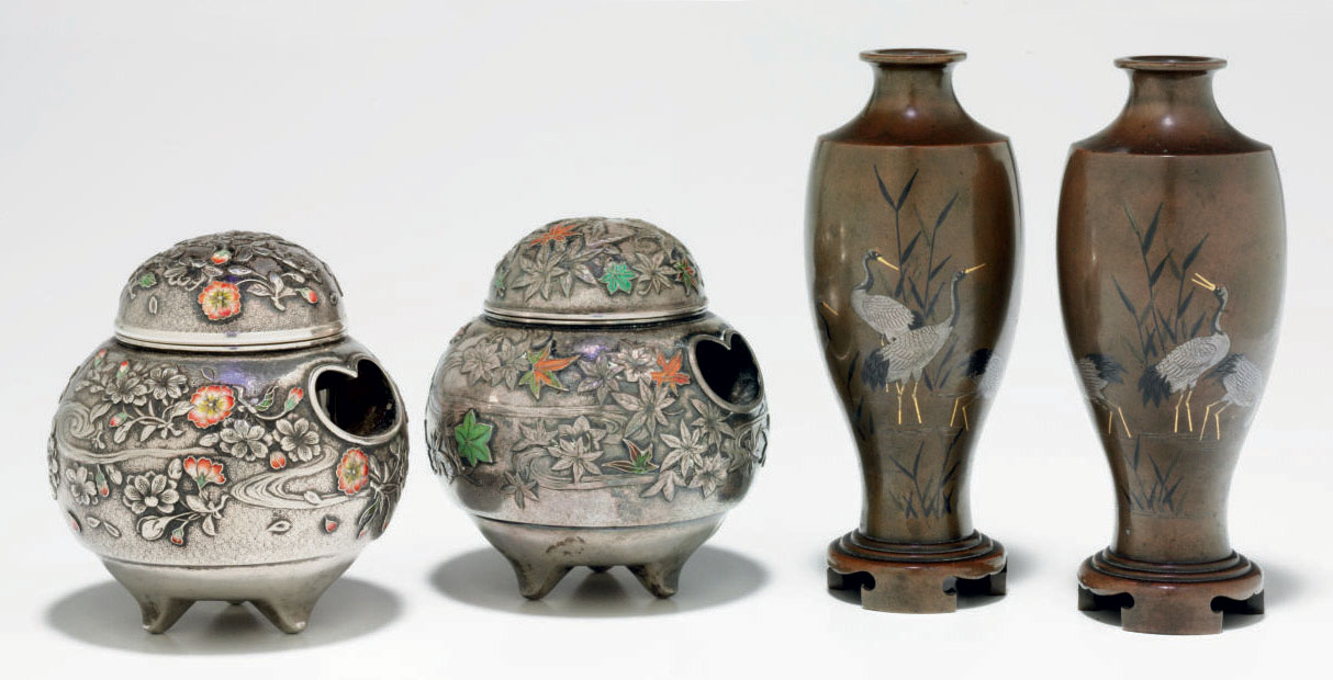 A pair of mixed-metal vases an