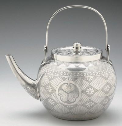 A silver tea kettle