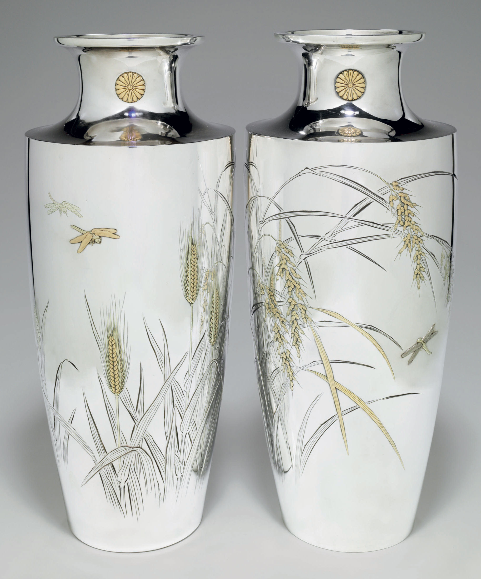 A pair of silver and gilt pres