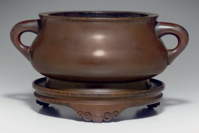 A BRONZE BOMBE CENSER AND A ST
