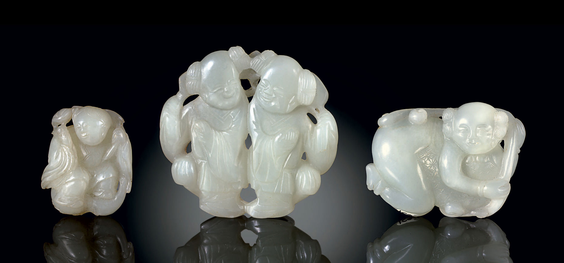 THREE PALE GREENISH-WHITE JADE FIGURAL CARVINGS