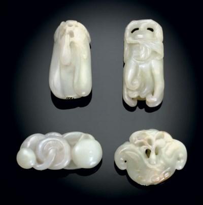 FOUR PALE GREENISH-WHITE JADE